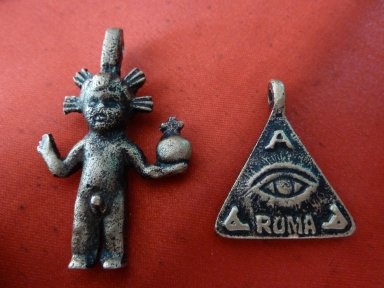 Agimat / anting-anting charms sold outside the Roman Catholic church in Taal, Batangas. showing Christian and Freemason imagery.